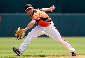 SARASOTA, FL - MARCH 05:  Shortstop J.J. Hardy #2 of the Baltimore Orioles just gets to this ground ball in the first inning against the Boston Red Sox during a Grapefruit League Spring Training Game at Ed Smith Stadium on March 5, 2011 in Sarasota, Flori