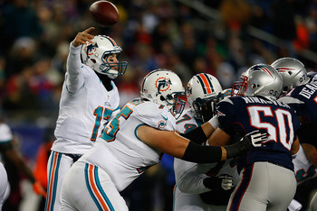 FOXBORO, MA - DECEMBER 30: Ryan Tannehill #17 of the Miami Dolphins throws against the New England Patriots in the second half at Gillette Stadium on December 30, 2012 in Foxboro, Massachusetts. (Photo by Jim Rogash/Getty Images)