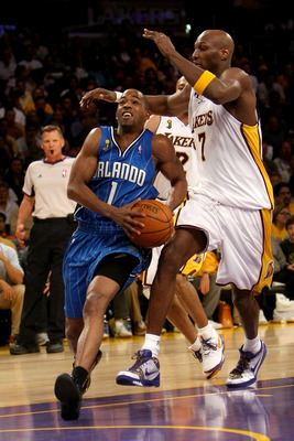 LOS ANGELES, CA - JUNE 07:  Rafer Alston #1 of the Orlando Magic drives to the basket past Lamar Odom #7  of the Los Angeles Lakers in Game Two of the 2009 NBA Finals at Staples Center on June 7, 2009 in Los Angeles, California. NOTE TO USER: User express
