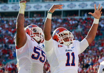 JACKSONVILLE, FL - OCTOBER 30:  Jordan Reed #11 and Mike Pouncey #55 of the Florida Gators celebrate a touchdown during the game against the Georgia Bulldogs at EverBank Field on October 30, 2010 in Jacksonville, Florida.  (Photo by Sam Greenwood/Getty Im