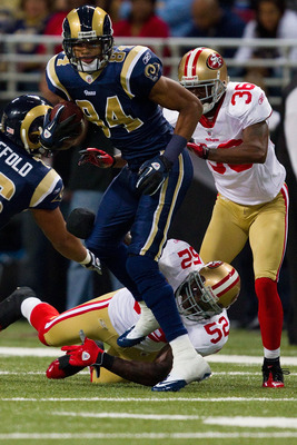 ST. LOUIS, MO - DECEMBER 26: Danario Alexander #84 of the St. Louis Rams slips out a tackle attempt by Patrick Willis #52 of the San Francisco 49ers at the Edward Jones Dome on December 26, 2010 in St. Louis, Missouri. The Rams beat the 49ers 25-17. (Phot