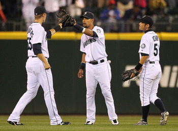 SEATTLE - AUGUST 03:  (L-R) Outfielders Michael Saunders #55, Franklin Gutierrez #21, and Ichiro Suzuki #51 of the Seattle Mariners celebrate after defeating the Texas Rangers 3-2 at Safeco Field on August 3, 2010 in Seattle, Washington. (Photo by Otto Gr
