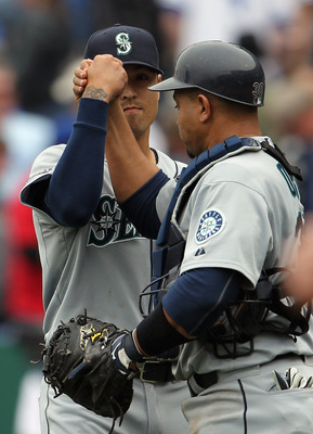 KANSAS CITY, MO - APRIL 17:  Relief pitcher Brandon League #43 of the Seattle Mariners celebrates with catcher Miguel Olivo #30 after the Mariners defeated the Kansas City Royals 3-2 to win the game on April 17, 2011 at Kauffman Stadium in Kansas City, Mi