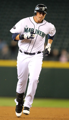 SEATTLE, WA - APRIL 13:  Justin Smoak #17 of the Seattle Mariners rounds the bases after hitting a solo home run in the sixth inning against the Toronto Blue Jays at Safeco Field on April 13, 2011 in Seattle, Washington. (Photo by Otto Greule Jr/Getty Ima