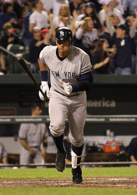 BALTIMORE, MD - APRIL 23:  Alex Rodriguez #13 of the New York Yankees tosses his bat after hitting a  grand slam home run against the Baltimore Orioles during the eighth inning at Oriole Park at Camden Yards on April 23, 2011 in Baltimore, Maryland.  (Pho