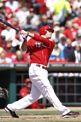 CINCINNATI, OH - APRIL 21: Joey Votto #19 of the Cincinnati Reds hits a solo home run in the fifth inning against the Arizona Diamondbacks at Great American Ball Park on April 21, 2011 in Cincinnati, Ohio. The Reds defeated the Diamondbacks 7-4. (Photo by