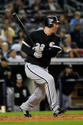 NEW YORK, NY - APRIL 25:  Adam Dunn #32 of the Chicago White Sox grounds out as his teammate Carlos Quentin scores in the third inning against the New York Yankees at Yankee Stadium on April 25, 2011 in the Bronx borough of New York City.  (Photo by Chris