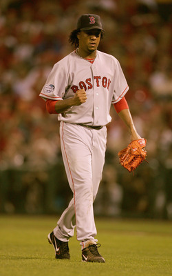 ST LOUIS - OCTOBER 26:  Pedro Martinez #45 of the Boston Red Sox pumps his fist as he walks off the field after ending the inning against the St. Louis Cardinals during game three of the World Series on October 26, 2004 at Busch Stadium in St. Louis, Miss