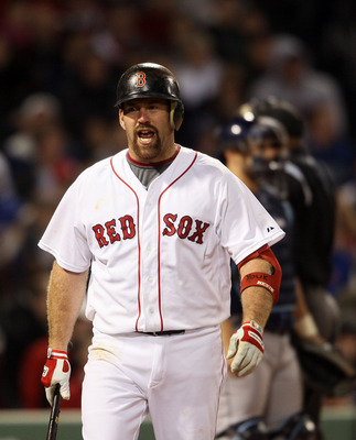 BOSTON, MA - APRIL 12:  Kevin Youkilis #20 of the Boston Red Sox reacts to his strikeout in the sixth inning against the Tampa Bay Rays on April 12, 2011 at Fenway Park in Boston, Massachusetts.  (Photo by Elsa/Getty Images)