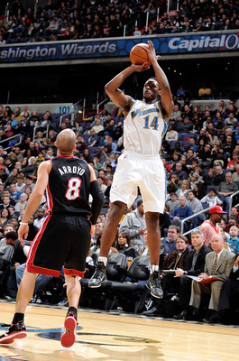 WASHINGTON, DC - DECEMBER 18:  Al Thornton #14 of the Washington Wizards  shoots over Carlos Arroyo #8 of the Miami Heat at the Verizon Center on December 18, 2010 in Washington, DC. NOTE TO USER: User expressly acknowledges and agrees that, by downloadin