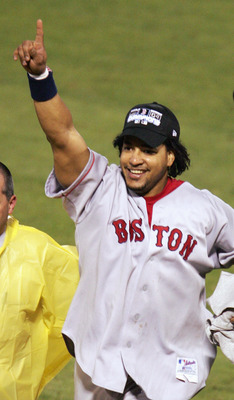 ST LOUIS - OCTOBER 27:  Manny Ramirez #24 of the Boston Red Sox celebrates the victory over the St. Louis Cardinals in game four of the World Series on October 27, 2004 at Busch Stadium in St. Louis, Missouri. The Red Sox defeated the Cardinals 3-0 to win