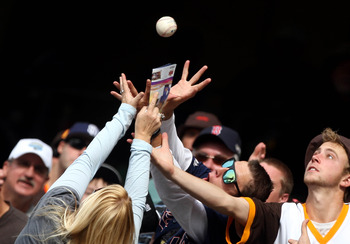 SAN DIEGO - APRIL 15:  Fans reach for a fly ball during a game between the Atlanta Braves and the San Diego Padres at Petco Park on April 15, 2010 in San Diego, California. (Photo by Donald Miralle/Getty Images)