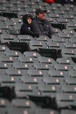 CHICAGO, IL - APRIL 07: Fans of the Chicago White Sox watch batting practice in their seats before the home opener against the Tampa Bay Rays at U.S. Cellular Field on April 7, 2011 in Chicago, Illinois. (Photo by Jonathan Daniel/Getty Images)