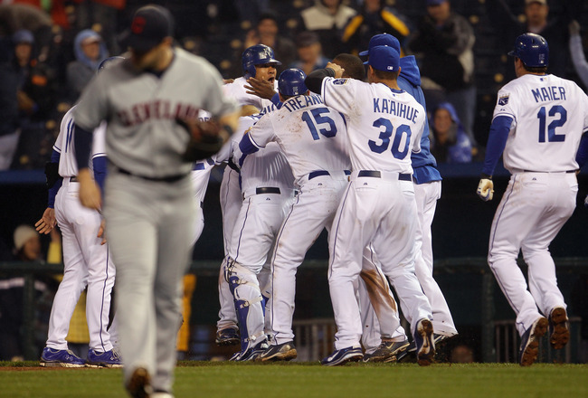 KANSAS CITY, MO - APRIL 21:  Melky Cabrera #53 of the Kansas City Royals is swarmed by teammates after knocking in the game-winning run to defeat  the Cleveland Indians 3-2 to win the game on April 21, 2011 at Kauffman Stadium in Kansas City, Missouri.  (