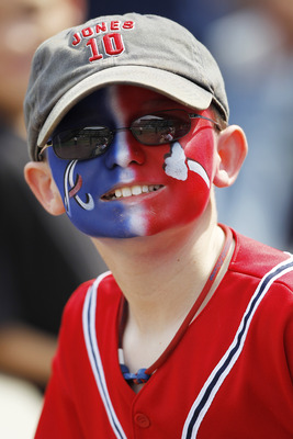 ATLANTA, GA - APRIL 9: A young Atlanta Braves fan looks on during the game against the Philadelphia Phillies at Turner Field on April 9, 2011 in Atlanta, Georgia. The Phillies won 10-2. (Photo by Joe Robbins/Getty Images)