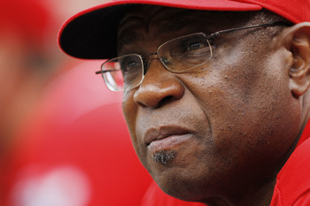 CINCINNATI, OH - MAY 1: Cincinnati Reds manager Dusty Baker looks on against the Florida Marlins at Great American Ball Park on May 1, 2011 in Cincinnati, Ohio. The Marlins defeated the Reds 9-5. (Photo by Joe Robbins/Getty Images)