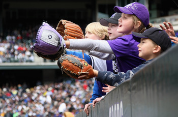 DENVER, CO - MAY 01:  Young fans hope to get a souvenir ball as the Colorado Rockies host the Pittsburgh Pirates at Coors Field on May 1, 2011 in Denver, Colorado. The Pirates defeated the Rockies 8-4.  (Photo by Doug Pensinger/Getty Images)