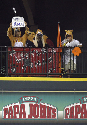 HOUSTON - JULY 30:  Lance Berkman's fan club 'The Little Pumas' hold up a sign displaying 'Thank You Puma!' from their perch in center field at Minute Maid Park on July 30, 2010 in Houston, Texas. There are unoffical reports that Berkman will be traded to