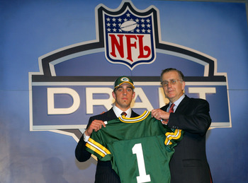 NEW YORK - APRIL 23:  Quarterback Aaron Rodgers (California) poses with NFL Commissioner Paul Tagliabue after Rodgers was drafted 24th overall by the Green Bay Packers during the 70th NFL Draft on April 23, 2005 at the Jacob K. Javits Convention Center in