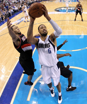 DALLAS, TX - APRIL 25:  Center Tyson Chandler #6 of the Dallas Mavericks takes a shot against Brandon Roy #7 of the Portland Trail Blazers in Game Five of the Western Conference Quarterfinals during the 2011 NBA Playoffs on April 25, 2011 at American Airl
