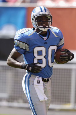CLEVELAND - AUGUST 21:  Wide receiver Charles Rogers #80 of the Detroit Lions carries the ball during the NFL preseason game against the Cleveland Browns on August 21, 2004 at Cleveland Browns Stadium in Cleveland, Ohio.  Cleveland defeated Detroit 17-10.