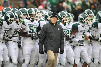 STATE COLLEGE, PA - NOVEMBER 27: Head coach Mark Dantonio of the Michigan State Spartans leads his team onto the field before a game against the Penn State Nittany Lions on November 27, 2010 at Beaver Stadium in State College, Pennsylvania. The Spartans w