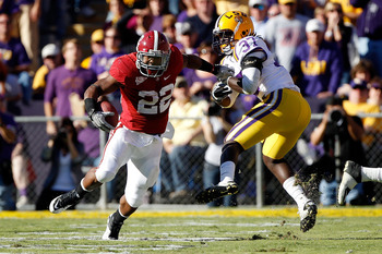 BATON ROUGE, LA - NOVEMBER 06:  Mark Ingram #22 of the Alabama Crimson Tide avoids a tackle by Karnell Hatcher #37 of the Louisiana State University Tigers at Tiger Stadium on November 6, 2010 in Baton Rouge, Louisiana.  (Photo by Chris Graythen/Getty Ima