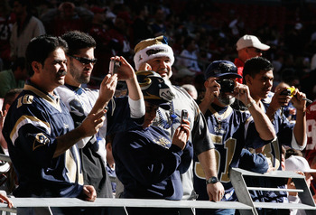 GLENDALE, AZ - DECEMBER 27:  Fans of the St. Louis Rams watch warm ups before the NFL game against the Arizona Cardinals at the Universtity of Phoenix Stadium on December 27, 2009 in Glendale, Arizona. The Cardinals defeated the Rams 31-10.  (Photo by Chr