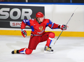 BUFFALO, NY - JANUARY 03: Denis Golubev #28 of Russia celebrates scoring the game-winning goal in a shootout against Sweden  during the 2011 IIHF World U20 Championship Semi Final game between Sweden and Russia on January 3, 2011 in Buffalo, New York. Rus