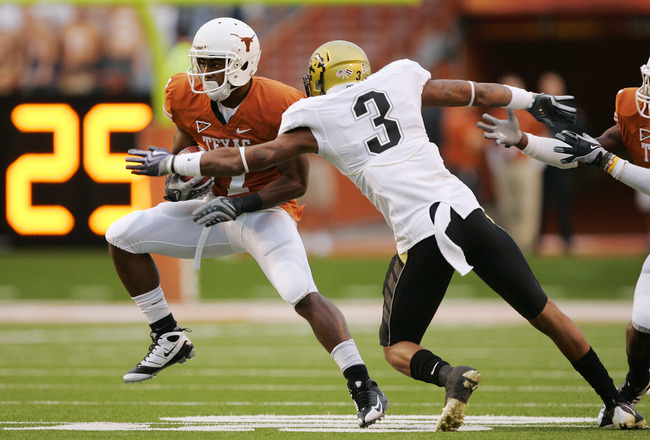 AUSTIN, TX - OCTOBER 10: Wide receiver John Chiles #7 of the Texas Longhorns makes a quick cut after catching a pass against cornerback Jimmy Smith #3 of the Colorado Buffaloes in the first quarter on October 10, 2009 at Darrell K Royal-Texas Memorial Sta