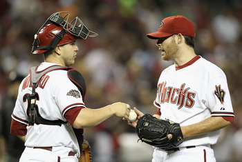 PHOENIX, AZ - APRIL 25:  Starting pitcher Ian Kennedy #31 of the Arizona Diamondbacks reacts with catcher Miguel Montero #26 after defeating the Philadelphia Phillies in the Major League Baseball game at Chase Field on April 25, 2011 in Phoenix, Arizona.