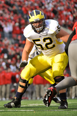 COLUMBUS, OH - NOVEMBER 27:  Stephen Schilling #52 of the Michigan Wolverines blocks against the Ohio State Buckeyes at Ohio Stadium on November 27, 2010 in Columbus, Ohio.  (Photo by Jamie Sabau/Getty Images)