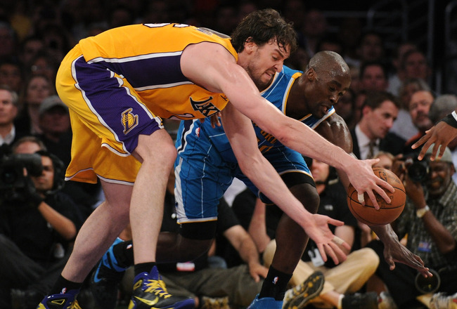 LOS ANGELES, CA - APRIL 26:  Pau Gasol #16 of the Los Angeles Lakers and Emeka Okafor #50 of the New Orleans Hornets battle for a loose ball in the third quarter in Game Five of the Western Conference Quarterfinals in the 2011 NBA Playoffs on April 26, 20