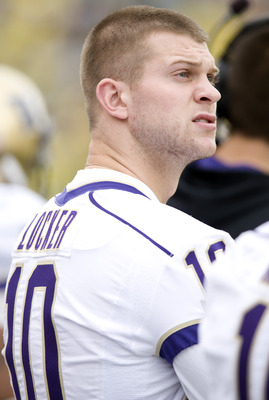 EUGENE, OR - NOVEMBER 6: Injured quarterback Jake Locker #10 of the Washington Huskies watches the action from the bench in the third quarter of the game against the Oregon Ducks at Autzen Stadium on November 6, 2010 in Eugene, Oregon. The Ducks won the g