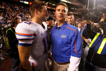 COLUMBIA, SC - NOVEMBER 14:  Head coach Urban Meyer and quarterback Tim Tebow #15 of the Florida Gators celebrate after a 24-14 victory over the South Carolina Gamecocks during their game at Williams-Brice Stadium on November 14, 2009 in Columbia, South C