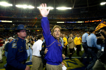 ATLANTA - DECEMBER 6:  Head coach Nick Saban of the LSU Tigers waves to the fans after LSU defeated the Georgia Bulldogs 34-13 to win the SEC Championship Game on December 6, 2003 at the Georgia Dome in Atlanta, Georgia.  (Photo by Jamie Squire/Getty Imag