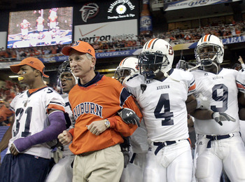 ATLANTA - DECEMBER 4:  Head coach Tommy Tuberville of the Auburn Tigers leads his team onto the field against the Tennessee Volunteers in the 2004 SEC Championship Game at the Georgia Dome on December 4, 2004 in Atlanta, Georgia. (Photo by Grant Halverson