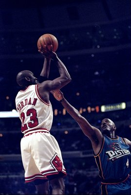 31 Mar 1998:  Guard Michael Jordan of the Chicago Bulls (left) in action against guard Joe Dumars of the Detroit Pistons during a game at the United Center in Chicago, Illinois.  The Bulls defeated the Pistons 106-101. Mandatory Credit: Jonathan Daniel  /