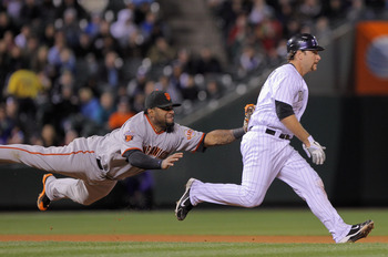 DENVER, CO - APRIL 19:  Thirdbaseman Pablo Sandoval #48 of the San Francisco Giants tags out Chris Iannetta #20 of the Colorado Rockies for the final out of the fifth inning at Coors Field on April 19, 2011 in Denver, Colorado.  (Photo by Doug Pensinger/G