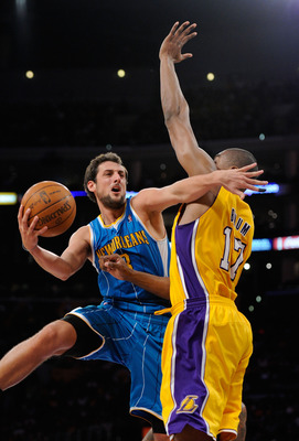LOS ANGELES, CA - APRIL 20:  Marco Belinelli #8 of the New Orleans Hornets goes up for a shot against Andrew Bynum #17 of the Los Angeles Lakers in Game Two of the Western Conference Quarterfinals in the 2011 NBA Playoffs on April 20, 2011 at Staples Cent
