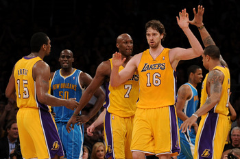 LOS ANGELES, CA - APRIL 26:  Pau Gasol #16 of the Los Angeles Lakers reacts in the third quarter with teammates Ron Artest #15 and Shannon Brown #12 while taking on the New Orleans Hornets in Game Five of the Western Conference Quarterfinals in the 2011 N