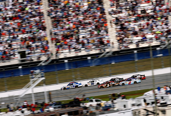 TALLADEGA, AL - APRIL 16:  Carl Edwards, driver of the #60 Fastenal Ford, leads a group of cars during the NASCAR Nationwide Series Aaron's 312 at Talladega Superspeedway on April 16, 2011 in Talladega, Alabama.  (Photo by Tom Pennington/Getty Images for
