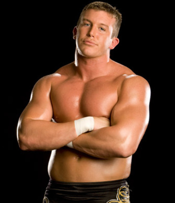 http://www.wwepictures.co.cc/wp-content/uploads/2011/03/WWE-Ted-DiBiase-Showing-His-Body-Muscle-.jpg