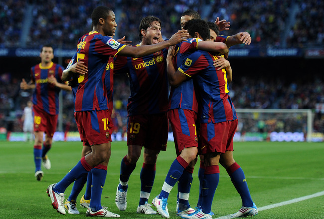 BARCELONA, SPAIN - APRIL 23:  David Villa (2nd R) of Barcelona celebrates scoring his sides opening goal with his teammates during the la Liga match between Barcelona and Osasuna at the Camp Nou stadium on April 23, 2011 in Barcelona, Spain.  (Photo by Ja
