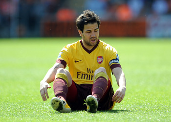 BLACKPOOL, ENGLAND - APRIL 10: Cesc Fabregas of Arsenal reacts during the Barclays Premier League match between Blackpool and Arsenal at Bloomfield Road on April 10, 2011 in Blackpool, England.  (Photo by Chris Brunskill/Getty Images)