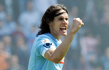 NAPLES, ITALY - APRIL 03:  Edinson Cavani of Napoli  celebrates after scoring the goal 2-2 during the Serie A match between SSC Napoli and SS Lazio at Stadio San Paolo on April 3, 2011 in Naples, Italy.  (Photo by Giuseppe Bellini/Getty Images)