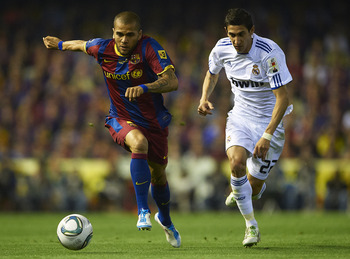 VALENCIA, BARCELONA - APRIL 20:  Daniel Alves (L) of Barcelona and Angel Di Maria of Real Madrid competes for the ball during the Copa del Rey final match between Real Madrid and Barcelona at Estadio Mestalla on April 20, 2011 in Valencia, Spain. Real Mad