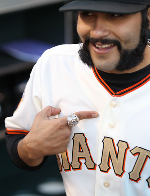 SAN FRANCISCO, CA - APRIL 09:  Sergio Romo #54 of the San Francisco Giants shows off his World Series ring before his game against the St. Louis Cardinals  at AT&T Park on April 9, 2011 in San Francisco, California.  (Photo by Jed Jacobsohn/Getty Images)
