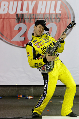 LEBANON, TN - APRIL 22:  Kyle Busch, driver of the #18 Dollar General Toyota celebrates in victory lane after winning the NASCAR Camping World Truck Series Bully Hill Vineyards 200 at Nashville Superspeedway on April 22, 2011 in Lebanon, Tennessee.  (Phot