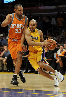 LOS ANGELES, CA - MAY 19:  Derek Fisher #2 of the Los Angeles Lakers drives with the ball as Grant Hill #33 of the Phoenix Suns defends in the third quarter of Game Two of the Western Conference Finals during the 2010 NBA Playoffs at Staples Center on May